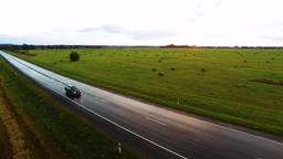 Flight over the cars. Wet road after rain. Aerial footage Footage