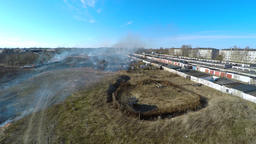 Burning grass at backyard. Garages. Aerial footage Footage