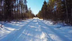 Winter country road, forest landscape. Trees covered with snow. Aerial footage Footage