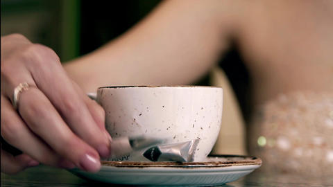 girl pours sugar into the coffee cup close up Footage