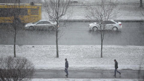 Winter Snowfall, cars a slowly driving along road Footage