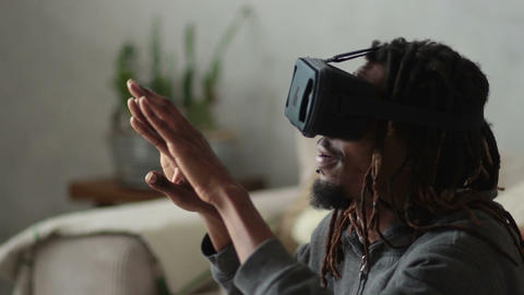 Man with virtual reality headset playing video games Footage