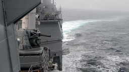 USS Antietam fires its close-in weapons system (CIWS) Footage