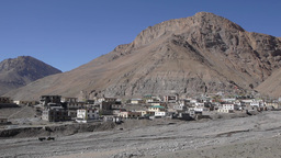 Village And Mountain And Tractor Passing,Kazaa,Spiti,India stock footage