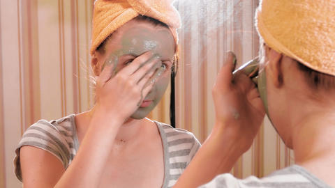 4K Girl Applies Face Mask While Looking in Mirror Footage