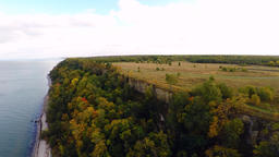 Autumn sunset. Cliff and fields. Aerial footage Footage