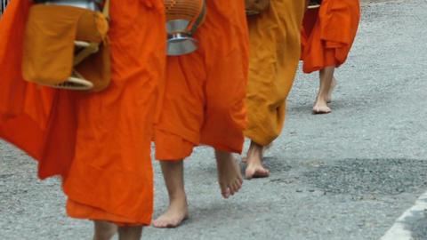 Buddhist monks walking barefoot along the street Footage