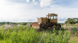 Old yellow tractor/excavator. Time lapse footage. Nature background Footage