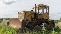 Old yellow tractor/excavator. Time lapse footage. Nature background ビデオ