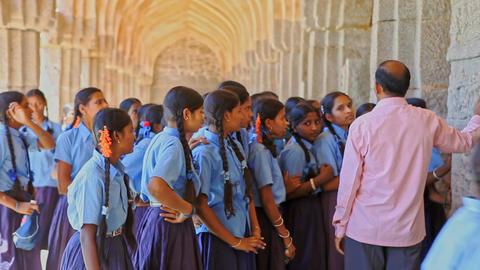 Teacher Explains History to Schoolgirls on Palace Terrace Footage