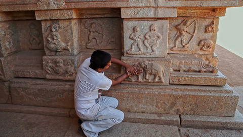 Local Guide Tells About Columns Decoration with Elephants Footage
