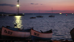 Boats in the sea with purple sky background 5 Footage