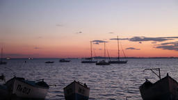 Boats in the sea with purple sky background Footage
