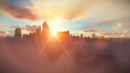 City skyline above clouds at sunset Animation