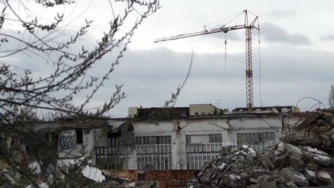 Industrial Crane On Building Demolition Site Handheld Footage