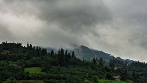 The movement of clouds over the mountains with trees Footage