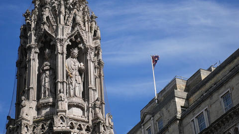 The flag of Britain and the sculpture of a woman with a cross Live Action