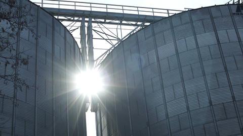 Industrial Grain Silos With Sun Flare Timelapse GIF