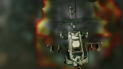 Military gunship flying in front of explosion and smoke Image