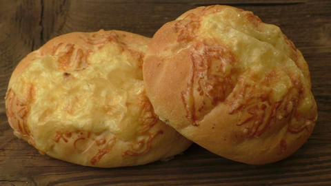 Baguette with melted cheese on wooden background ライブ動画
