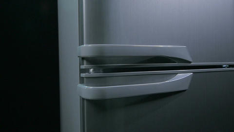 Camera Moves Around Fridge with Doors with White Handles Footage