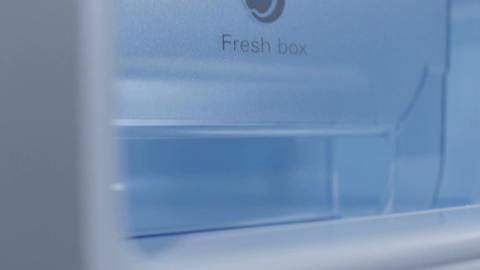 Soft Focus Closeup Camera Moves from Fridge Corner along Side Footage