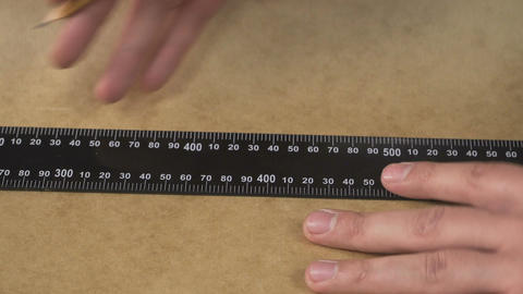 Man's hands cutting carton with a knife Filmmaterial