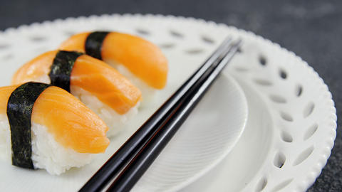 Sushi served on plate with chopsticks Live Action