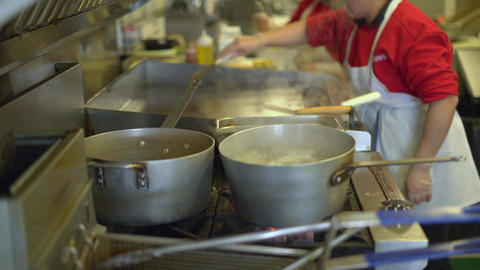 Pots and pans in a busy commercial kitchen Footage
