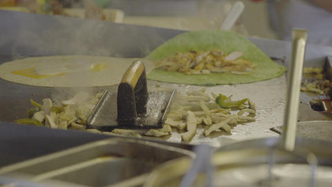 Sliced chicken fajita and onions on a stove top Footage