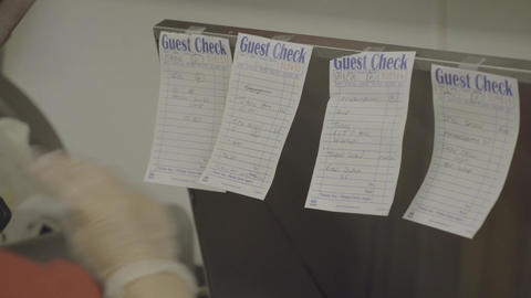 Cook graps order check for preparation Footage