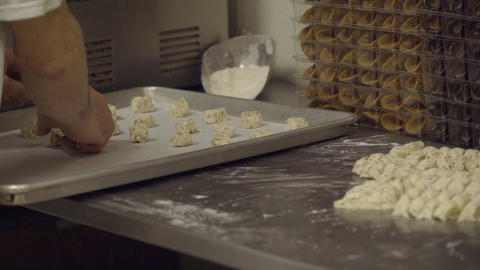 Italian baker puts cookie dough onto tray Footage