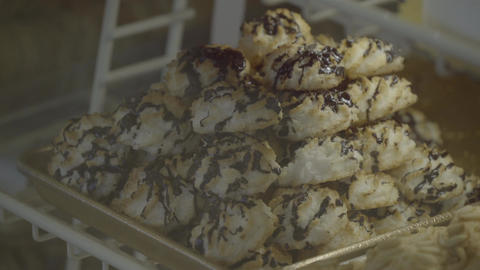 Chocolate covered coconut macaroons on display Footage