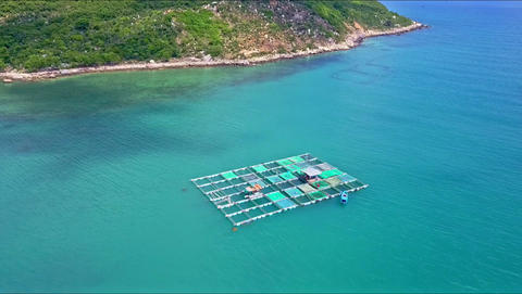 Drone Approaches Floating on Sea Lobster Farm by Coast Footage
