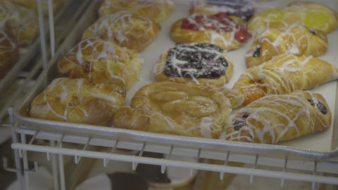 Fresh pastries are placed in case Footage