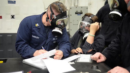 Sailors on USS Essex conduct a chemical, biological, and radiological drill Footage