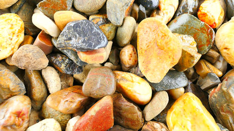 Wet stony pavement from natural pebbles. Colorful rounded stones, traditional bu Live Action