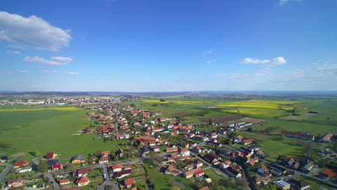 Aerial view of village and farm fields in spring