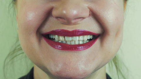 Woman with red pomade show teeth, smile in front camera. Mouth. Face. Make up Footage