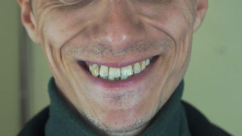 Adult man pronounce words in front camera. Mouth. Teeth. Bristle. Smiling Footage