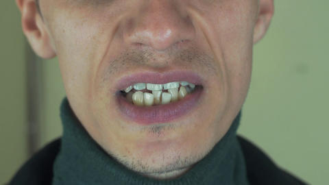 Adult man pronounce words in front camera. Mouth. Sing song. Bristle. Teeth Footage