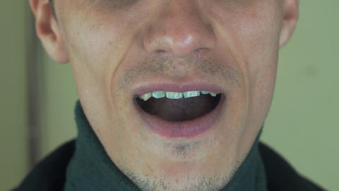 Adult man pronounce some words in front camera. Mouth. Sing song. Bristle. Smile Footage
