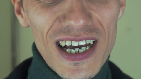 Man with bristle pronounce some words in camera. Open mouth. Teeth. Sing song Footage