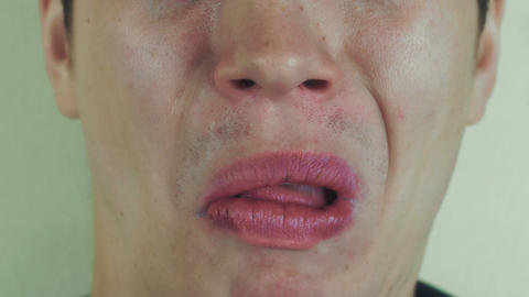 Young man play the ape in front camera. Open mouth pronounce words. White teeth Footage