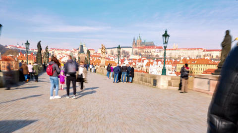 Hyperlapse shot of walking tourists on the Charles bridge