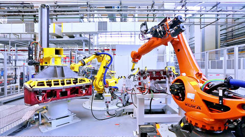 Measured robotic arms at car factory Footage