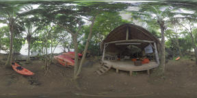360 VR Hut and boats on the shadowy river bank in Mauritius Archivo