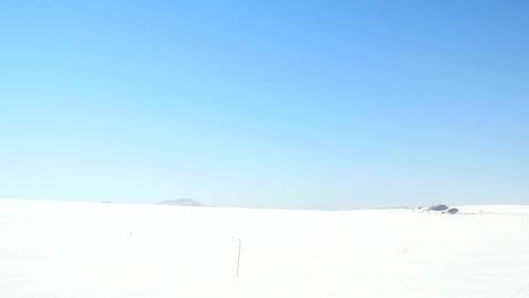 Winter tourist with snowshoes walk in snowy drift. Hiker... Videos de Stock