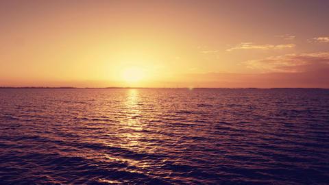 Sunrise over smooth wavy sea, timelapse Footage