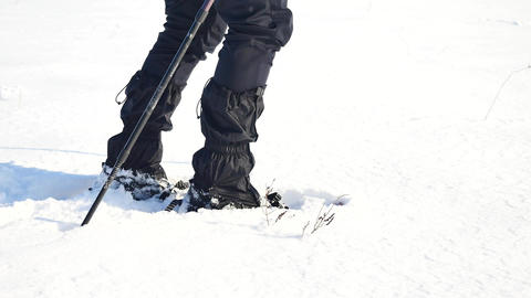 Man legs with snowshoes walk in snow. Detail of winter hike in snowdrift, snowsh Footage